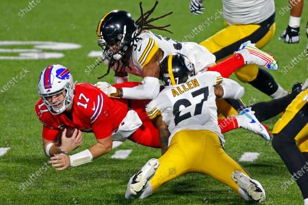 Buffalo Bills quarterback Josh Allen (17) is tackled by Pittsburgh Steelers strong safety Terrell Edmunds (34) and Marcus Allen (27) during the first half of an NFL football game in Orchard Park, N.Y., . The Bills won 26-15