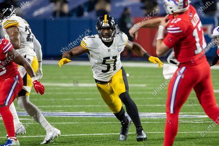 Pittsburgh Steelers inside linebacker Avery Williamson (51) watches as Buffalo Bills quarterback Josh Allen (17) releases a pass during an NFL football game, in Orchard Park, N.Y