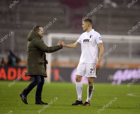 Stock Image of l-r: Chef-Trainer Manuel Baum (FC Schalke 04) and Alfred Finnbogason #27 (FC Augsburg)