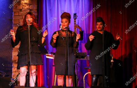 Musicians with Chrisette Michele performs during the socially distanced and limited capacity concert at City Winery, in Atlanta