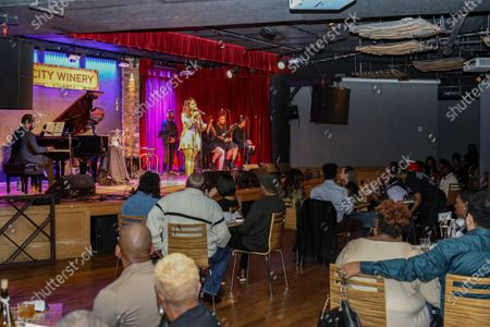 Socially distanced crowd watches Chrisette Michele perform during the limited capacity concert at City Winery, in Atlanta