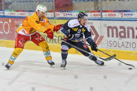 #66 Tim Grossniklaus (Tigers) against #13 Marco Mueller (Ambri)
