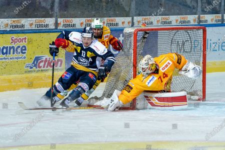 #13 Marco Mueller (Ambri) against #19 Pascal Berger (Tigers) and #74 goalkeeper Ivars Punnenovs (Tigers)
