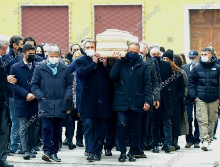 Stock Photo of Funeral of Paolo Rossi. The coffin carried on the shoulders of the former teammates of the national team and his son Alessandro. Antonio Cabrini, Marco Tardelli, Giancarlo Antognoni and Fulvio Collovati were recognized in the front row