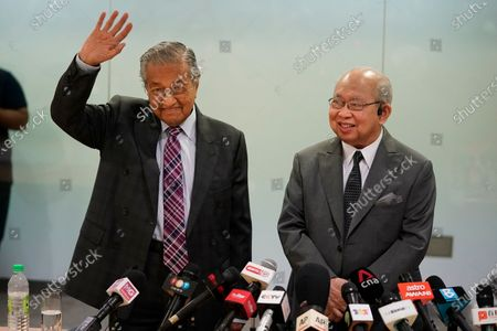 Malaysia's former Prime Minister Mahathir Mohamad, left, and politician Tengku Razaleigh Hamzah react after a press conference in Kuala Lumpur, Malaysia, on . Mahathir said the current government may fall if lawmakers reject the proposed 2021 national budget in the final vote in Parliament on Tuesday