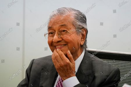 Malaysia's former Prime Minister Mahathir Mohamad, reacts during a press conference in Kuala Lumpur, Malaysia, on . Mahathir said the current government may fall if lawmakers reject the proposed 2021 national budget in the final vote in Parliament on Tuesday