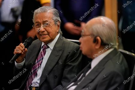 Malaysia's former Prime Minister Mahathir Mohamad, left, speaks next to politician Tengku Razaleigh Hamzah during a press conference in Kuala Lumpur, Malaysia, on . Mahathir said the current government may fall if lawmakers reject the proposed 2021 national budget in the final vote in Parliament on Tuesday