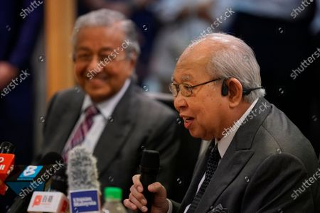 Politician Tengku Razaleigh Hamzah, right, speaks as Malaysia's former Prime Minister Mahathir Mohamad, during a press conference in Kuala Lumpur, Malaysia, on . Mahathir said the current government may fall if lawmakers reject the proposed 2021 national budget in the final vote in Parliament on Tuesday
