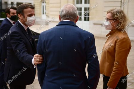 French President Emmanuel Macron (L) is welcomed by OECD's Secretary General Angel Gurria (C) and France's representative at the OECD Muriel Penicaud (R) as he arrives for a ceremony marking the 60th anniversary of the creation of the Organisation for Economic Co-operation and Development (OECD), at the OECD headquarters in Paris, France, 14 December 2020.