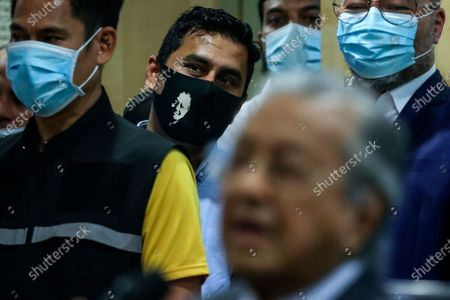 Former Malaysia Prime Minister Mahathir Bin Mohamad supporter wears face mask display Mahathir face while he speech during press conference in Kuala Lumpur, Malaysia, 14 December 2020. Tengku Razaleigh also UMNO veteran claimed that current prime minister Muhyiddin Yassin is not a legitimate prime minister.