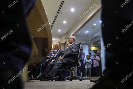 Former Malaysia Prime Minister Mahathir Bin Mohamad  (C-L) and United Malays National Organisation (UMNO) advisory board chairman Tengku Razaleigh Hamzah (C-R) react during press conference in Kuala Lumpur, Malaysia, 14 December 2020. Tengku Razaleigh also UMNO veteran claimed that current prime minister Muhyiddin Yassin is not a legitimate prime minister.