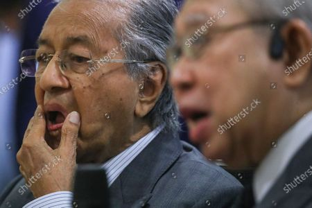 Former Malaysia Prime Minister Mahathir Bin Mohamad  (L) and United Malays National Organisation (UMNO) advisory board chairman Tengku Razaleigh Hamzah (R) react during press conference in Kuala Lumpur, Malaysia, 14 December 2020. Tengku Razaleigh also UMNO veteran claimed that current prime minister Muhyiddin Yassin is not a legitimate prime minister.