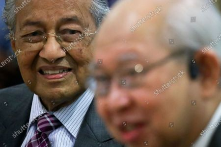 Former Malaysia Prime Minister Mahathir Bin Mohamad  (L) looks on United Malays National Organisation (UMNO) advisory board chairman Tengku Razaleigh Hamzah (R) give a speech during press conference in Kuala Lumpur, Malaysia, 14 December 2020. Tengku Razaleigh also UMNO veteran claimed that current prime minister Muhyiddin Yassin is not a legitimate prime minister.