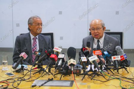 Stock Image of Former Malaysia Prime Minister Mahathir Bin Mohamad  (L) and United Malays National Organisation (UMNO) advisory board chairman Tengku Razaleigh Hamzah (R) react during press conference in Kuala Lumpur, Malaysia, 14 December 2020. Tengku Razaleigh also UMNO veteran claimed that current prime minister Muhyiddin Yassin is not a legitimate prime minister.