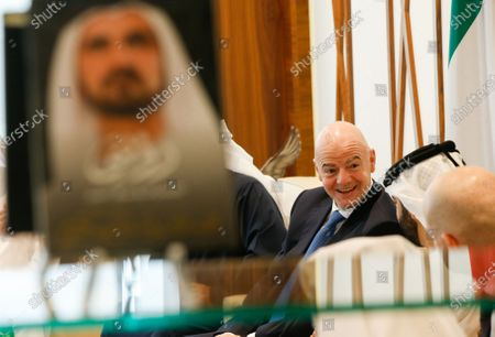 FIFA President Gianni Infantino talks with Sheikh Mansour bin Mohammed bin Rashid Al Maktoum, Chairman of Dubai Supreme Committee of Crisis and Disaster Management next to a portrait of Sheikh Mohammed bin Rashid Al Maktoum, Vice President and Prime Minister of the UAE and Ruler of Dubai, during his visit in Dubai, United Arab Emirates, 14 December 2020.