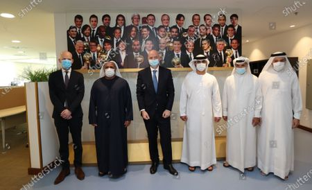FIFA President Gianni Infantino (3-L) poses for group photo with with Sheikh Mansour bin Mohammed bin Rashid Al Maktoum (3-R), Chairman of Dubai Supreme Committee of Crisis and Disaster Management and other officials during his visit in Dubai, United Arab Emirates, 14 December 2020.