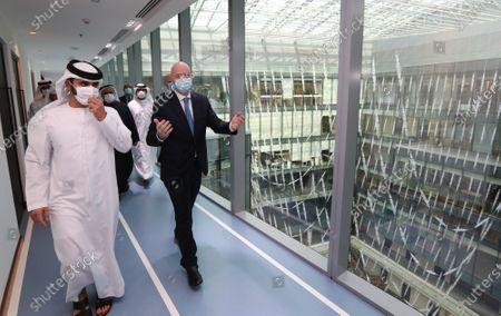 FIFA President Gianni Infantino (R) talks with Sheikh Mansour bin Mohammed bin Rashid Al Maktoum, Chairman of Dubai Supreme Committee of Crisis and Disaster Management during his visit in Dubai, United Arab Emirates, 14 December 2020.