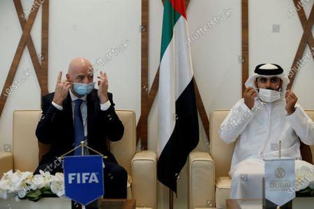 FIFA President Gianni Infantino (L) talks with Sheikh Mansour bin Mohammed bin Rashid Al Maktoum, Chairman of Dubai Supreme Committee of Crisis and Disaster Management during his visit in Dubai, United Arab Emirates, 14 December 2020.