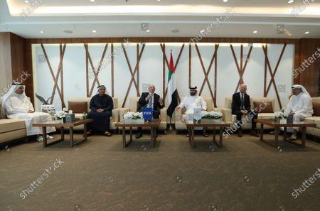 FIFA President Gianni Infantino (3-L) talks with Sheikh Mansour bin Mohammed bin Rashid Al Maktoum (3-R), Chairman of Dubai Supreme Committee of Crisis and Disaster Management during his visit in Dubai, United Arab Emirates, 14 December 2020.
