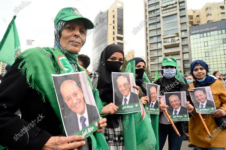 Students and supporters of the Shiite Amal group of Parliament Speaker Nabih Berri carry his pictures during a protest in front of the Ministry of Education in Beirut, Lebanon, 14 December 2020. Universities will update the exchange rate to 3,900 Lebanese pounds to the US dollar, after it was officially stabilized at 1,500 Lebanese pounds to the dollar 23 years ago amid the economic crisis in the country.