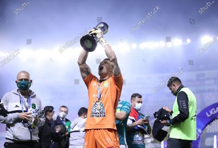 Stock Photo of Leon's goalkeeper Rodolfo Cota (C) celebrates with the trophy after the second leg of the final of the 2020 Liga MX Guardianes tournament against UNAM Pumas in Leon, Mexico, on Dec. 13, 2020. (Xinhua/Carlos Ramirez/Straffon Images)