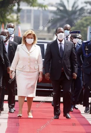 Ivorian president Alassane Ouattara (R) and his wife Dominique Ouattara (L) arrive at the inauguration of Ivorian President Alassane Ouattara at the presidential palace in Abidjan, Ivory Coast, 14 December 2020.