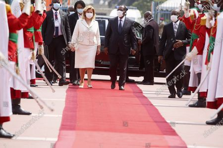 Ivorian president Alassane Ouattara (CR) and his wife Dominique Ouattara (CL) arrive at the inauguration of Ivorian President Alassane Ouattara at the presidential palace in Abidjan, Ivory Coast, 14 December 2020.