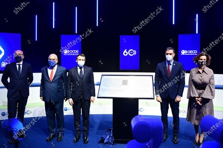 Stock Photo of From Left to right, European Council President Charles Michel, OECD's Secretary General Angel Gurria, French President Emmanuel Macron, Spanish Government's Head Pedro Sanchez, and UNESCO general director Audrey Azoulay, pose after unveiling a commemorative plaque during a ceremony marking the 60th anniversary of the creation of the Organization for Economic Co-operation and Development (OECD), at its headquarters in Paris