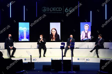 Stock Photo of From left to right, European Council President Charles Michel, French President Emmanuel Macron, OECD's Secretary General Angel Gurria, and Spanish Government's Head Pedro Sanchez attend a video conference with, on screens from left to right, Colombia President Ivan Duque, New-Zealand Prime minister Jacinda Ardern, and the President of the European Commission Ursula Von der Leyen as part of a ceremony marking the 60th anniversary of the creation of the Organization for Economic Co-operation and Development (OECD), at its headquarters in Paris