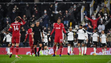 Joel Matip of Liverpool reacts towards Referee Andre Marriner following Bobby De Cordova-Reid of Fulham goal 1-0