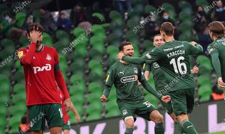 Lokomotiv player Vedran Corluka (left), Krasnodar players Marcus Berg (second left) and Viktor Claesson (second right)