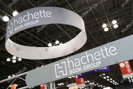 Signs for Hachette Book Group are displayed at BookExpo America in New York. Hachette cancelled a memoir by Woody Allen, whose daughter Dylan Farrow has alleged he sexually abused her, after employees staged a walkout in protest. Skyhorse Publishing later released the book