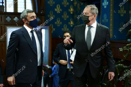 Released by Russian Foreign Ministry Press Service, Russian Foreign Minister Sergey Lavrov, right, and UAE's Foreign Affairs Minister Sheikh Abdullah bin Zayed bin Sultan Al Nahyan enter a hall for their talks in Moscow, Russia