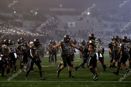 Army running back Brandon Walters (11) reacts against Navy during the second half of an NCAA college football game, in West Point, N.Y. It was the 121st playing of the Army-Navy game played in Michie Stadium at the United States Military Academy. Army defeated Navy 15-0