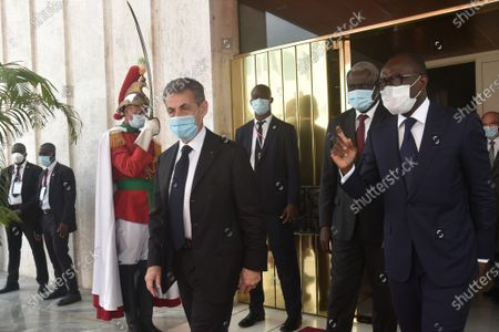 Former French President Nicolas Sarkozy (L) and  Benin President Patrice Talon (R) attend the  investiture of Ivorian President Alassane Ouattara at the presidential palace in Abidjan, Ivory Coast, 14 December 2020.