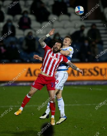 Rob Dickie of QPR  beats Steven Fletcher of Stoke City to a header
