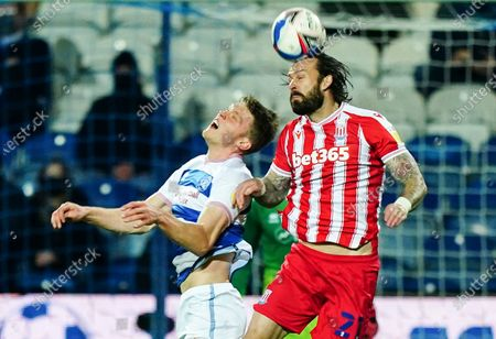 Steven Fletcher of Stoke City battles with Rob Dickie of QPR