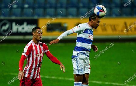 Niko Hamalainen of QPR heads ss Thomas Ince of Stoke City looks on