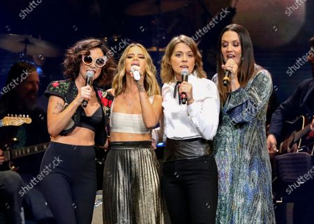 Amanda Shires, from left, Maren Morris, Brandi Carlile, and Natalie Hemby of The Highwomen perform at Loretta Lynn's 87th Birthday Tribute at Bridgestone Arena, in Nashville, Tenn. The Highwomen won three awards, including album, song and duo/group of the year, at the Americana Honors and Awards and the late John Prine was given artist of the year. The Americana Music Association announced the winners online this year after their awards show, normally held in Nashville, Tennessee, was cancelled because of the pandemic