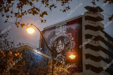 Stock Image of A view of the facade painting 'Liberte Egalite Fraternite' by US artist Shepard Fairey, aka OBEY, in Paris, France, 14 December 2020. The giant fresco was hijacked overnight from 13 to 14 December by an anonymous collective who crossed out the motto 'liberty, equality, fraternity' to write 'Marianne cries' as a political gesture against France's controversial global security law and police violences.