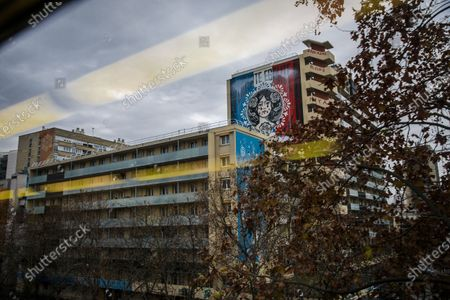 Stock Photo of A view of the facade painting 'Liberte Egalite Fraternite' by US artist Shepard Fairey, aka OBEY, in Paris, France, 14 December 2020. The giant fresco was hijacked overnight from 13 to 14 December by an anonymous collective who crossed out the motto 'liberty, equality, fraternity' to write 'Marianne cries' as a political gesture against France's controversial global security law and police violence.