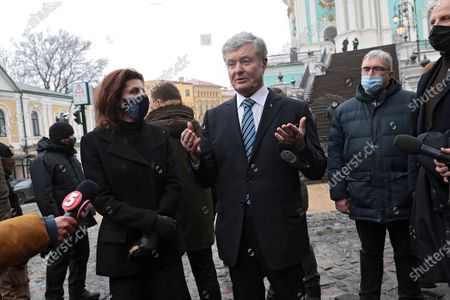 Fifth President of Ukraine, European Solidarity MP Petro Poroshenko (C) accompanied by his wife Maryna Poroshenko speaks to the press after the liturgy in St Andrew's Church that was reopened after 11 years of restoration works, Kyiv, capital of Ukraine.
