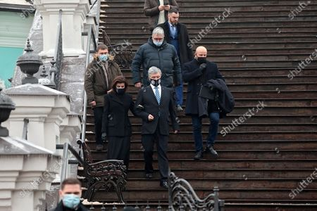 Stock Image of Fifth President of Ukraine, European Solidarity MP Petro Poroshenko (C) and his wife Maryna Poroshenko leave after the liturgy in St Andrew's Church that was reopened after 11 years of restoration works, Kyiv, capital of Ukraine.