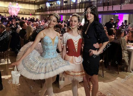 """In this image taken from video, choreographer Melanie Hamrick poses for a photo with young dancers at the gala of Youth America Grand Prix, the world's largest ballet scholarship competition,, after the U.S. premiere of her new ballet, """"Porte Rouge"""" (Red Door). Hamrick's Live Arts Global company is producing """"A Night at the Ballet,"""" a free streaming event that premieres on Wednesday. The event will treat ballet-starved fans to dancers from America's top companies performing excerpts of classical ballets like """"Romeo and Juliet, """"The Nutcracker"""" and """"Don Quixote"""