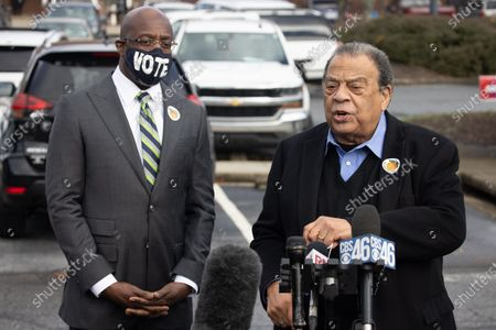 Former Ambassador Andrew Young and Democratic Senate Candidate Reverend Raphael Warnock hold a press conference after voting at the CT Martin Recreation Center in Atlanta, Georgia on December 14th, the first day of early voting.