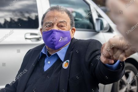 Former Ambassador Andrew Young greets supporters after voting at the CT Martin Recreation Center in Atlanta, Georgia on December 14th, the first day of early voting.