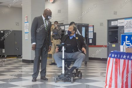 Former Ambassador Andrew Young and Democratic Senate Candidate Reverend Raphael Warnock vote at the CT Martin Recreation Center in Atlanta, Georgia on December 14th, the first day of early voting.