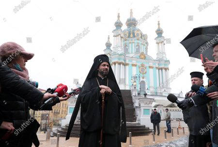 Exarch of the Ecumenical Patriarch of Constantinople Bartholomew I, Bishop Michael (Anishchenko) of Comana speaks to the press outside St Andrew's Church that was opened after the 11-year-long restoration process, Kyiv, capital of Ukraine.