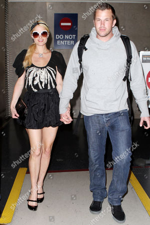 Editorial picture of Paris Hilton and Doug Reinhardt arriving at the LAX airport, Los Angeles, America - 22 Mar 2010