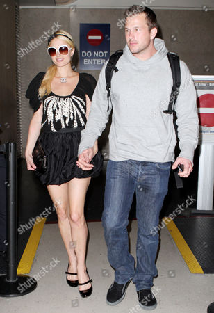 Editorial photo of Paris Hilton and Doug Reinhardt arriving at the LAX airport, Los Angeles, America - 22 Mar 2010
